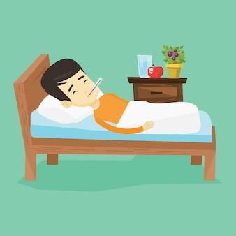Uomo malato con il termometro che si situa a letto.