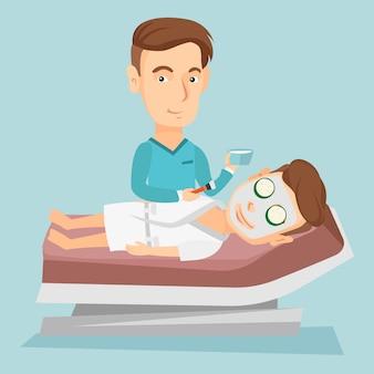 Uomo nel salone di bellezza durante la procedura di cosmetologia