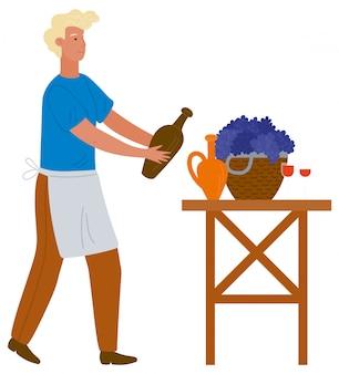 Uomo nel versare il vino dal vaso di terracotta
