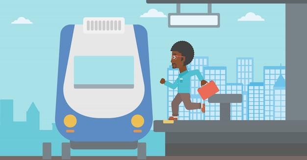 Uomo ritardatario che corre per il treno.