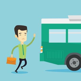 Uomo ritardatario che corre per l'autobus.