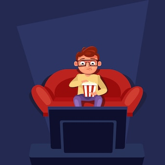 Uomo seduto al divano guarda la tv mangiando popcorn
