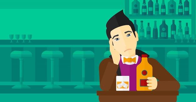 Uomo triste con bottiglia e bicchiere
