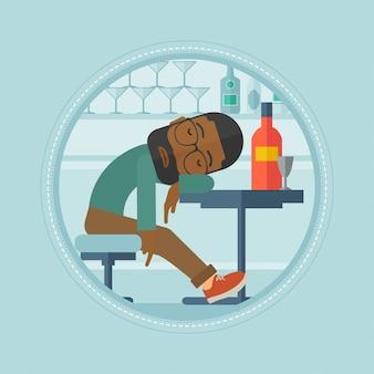 Uomo ubriaco che dorme nel bar