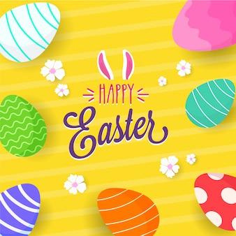 Uova colordul su sfondo giallo vibrante con fiori bianchi. buona pasqua testo con orecchie da coniglio.