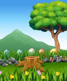 Uova di pasqua colorate su erba verde con un bellissimo paesaggio
