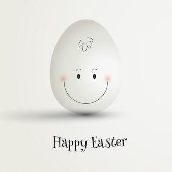 Uovo di pasqua con disegnata a mano faccia felice