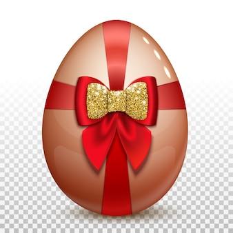Uovo di pasqua con fiocco in raso rosso e glitter oro.