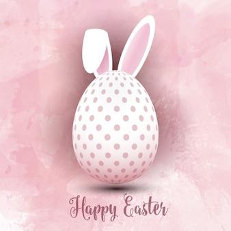 Uovo di pasqua con le orecchie di coniglio su uno sfondo acquerello