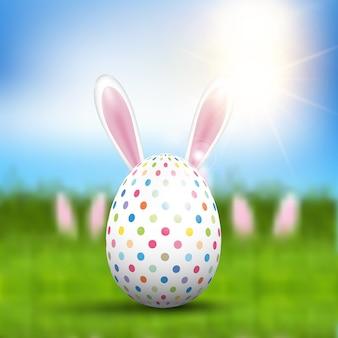Uovo di pasqua con orecchie da coniglio