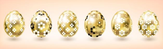 Uovo di pasqua in oro giallo con decoro floreale, sfondo chiaro