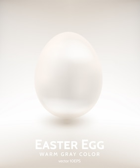 Uovo di pasqua in porcellana di colore grigio caldo