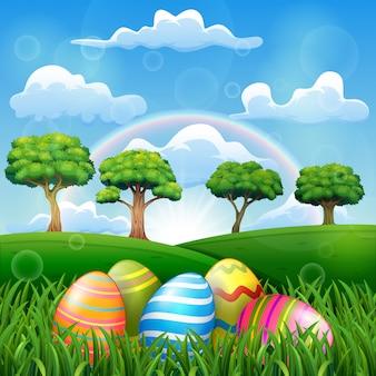 Uovo di pasqua sul campo in erba con uno sfondo arcobaleno