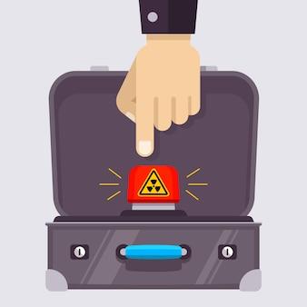 Valigia aperta con un pulsante nucleare rosso