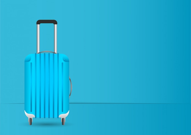 Valigia blu / bagaglio su sfondo blu pastello
