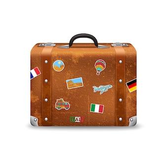 Valigia di viaggio vecchio stile con adesivi di viaggio