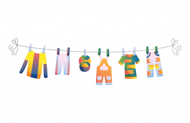 Vari oggetti di vestiti per bambini sulla corda isolato