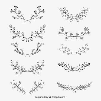 Varietà di abbozzati ornamenti floreali