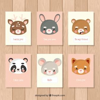 Varietà di carte con volti carini di animali
