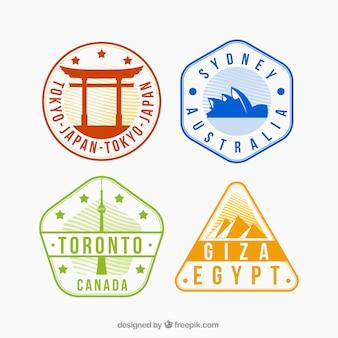 Varietà di francobolli colorati della città in disegno piatto