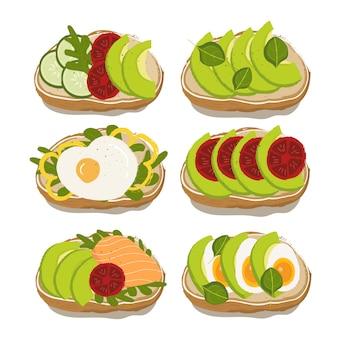 Varietà di panini per una dieta sana con avocado, pomodoro, uova, salmone, basilico e cetriolo