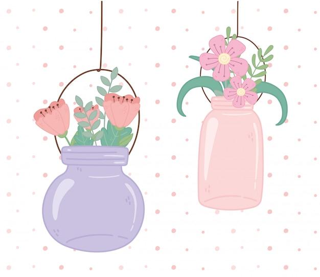 Vasi di mason in vetro con fiori appesi decorazione