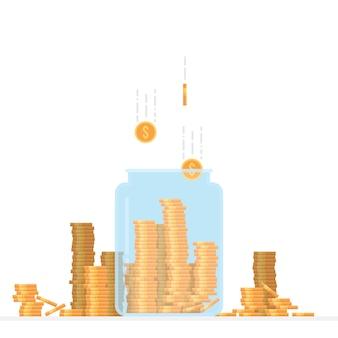 Vaso di vetro riempito con monete del dollaro
