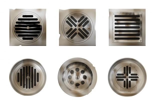 Vecchi fori di drenaggio della doccia con coperture arrugginite o sporche isolate su bianco
