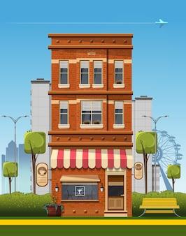 Vecchia casa di mattoni con un caffè e una città moderna.