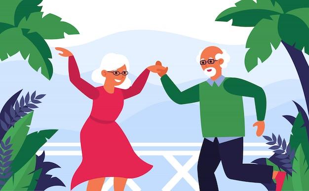 Vecchie coppie che godono della vacanza e del ballare