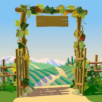 Vecchio cancello in legno fattoria con cartello, uva e paesaggio mediterraneo con vigneti