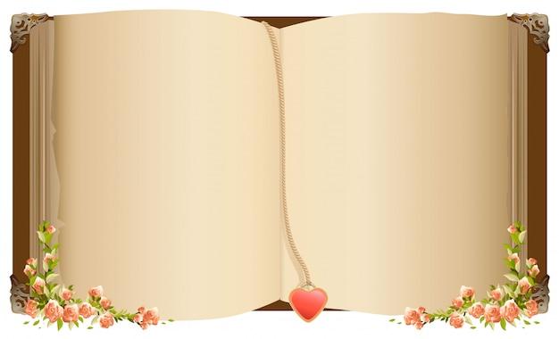 Vecchio libro aperto con segnalibro a forma di cuore