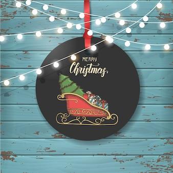 Vector etichetta vintage di natale con la slitta di babbo natale con regali e albero di natale.