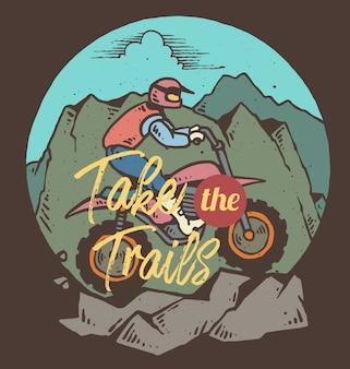 Vector l'illustrazione del motociclista che guida su una montagna