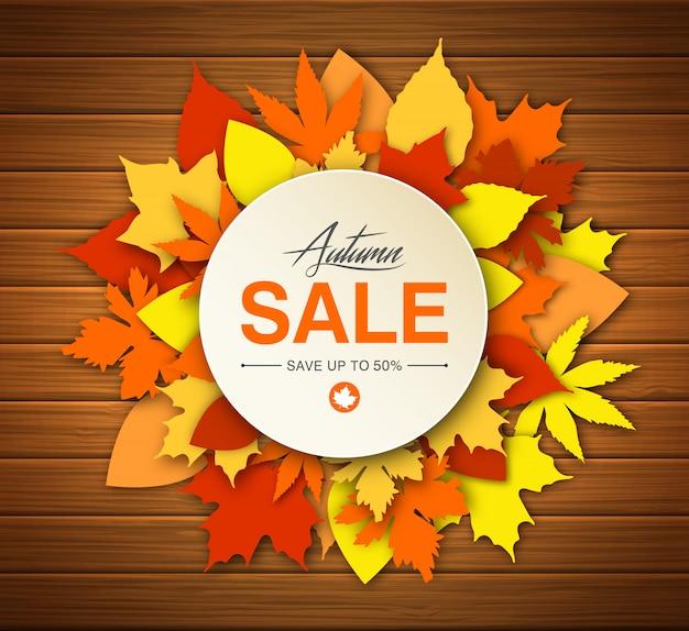 Vendita d'autunno con foglie colorate