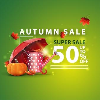 Vendita d'autunno, due striscioni sconto orizzontale sotto forma di un nastro con annaffiatoio da giardino