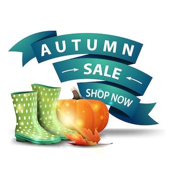 Vendita di autunno, sconto banner web cliccabile in forma di nastri con stivali di gomma e zucca