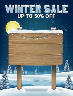 Vendita di inverno con cartello in legno sul lago d'inverno
