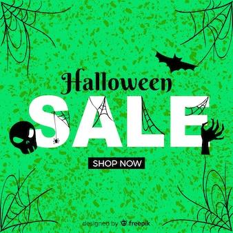 Vendite di halloween con ragnatele su sfondo verde