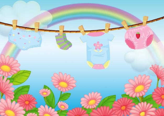 Vestiti da neonato vicino al giardino