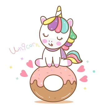 Vettore di unicorno carino con ciambella dolce