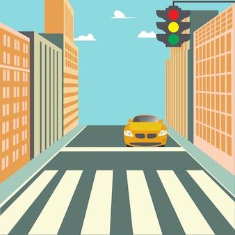 Via della città con edifici, semaforo, attraversamento pedonale e auto