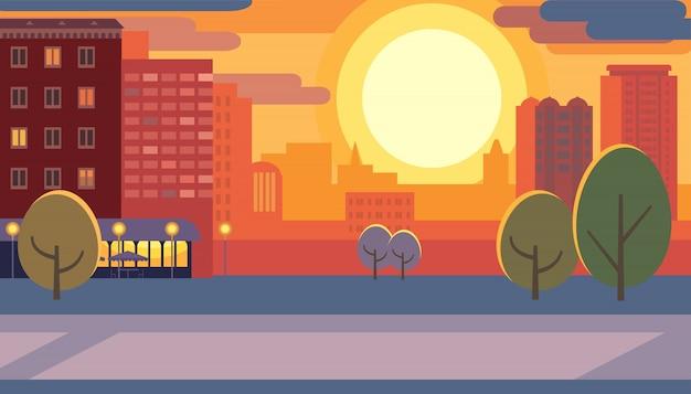 Via della città durante l'illustrazione piana di vettore di tramonto