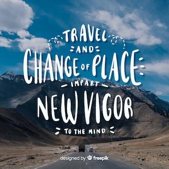 Viaggiare lettering sfondo con foto