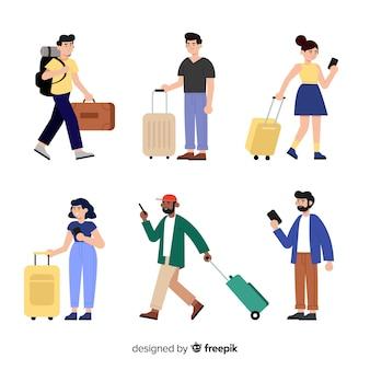 Viaggiatori con la collezione di valigie