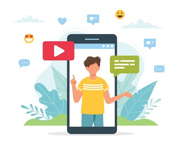 Video blogger maschio sullo schermo dello smartphone.