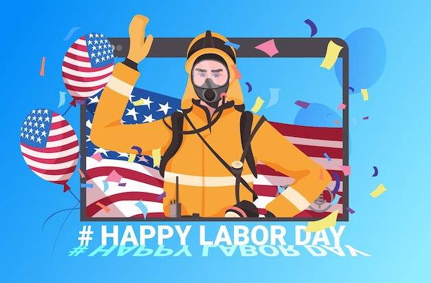Vigile del fuoco in uniforme con la celebrazione felice della festa del lavoro della bandiera degli stati uniti
