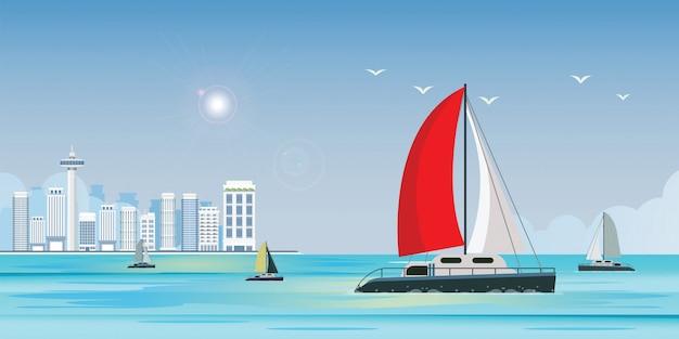 Vista blu del mare con l'yacht di lusso della nave di navigazione nel mare sull'insegna di vista della città