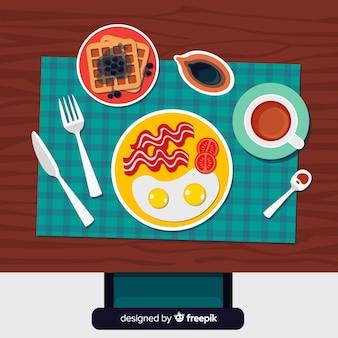Vista dall'alto del tavolo da ristorante elegante con design piatto