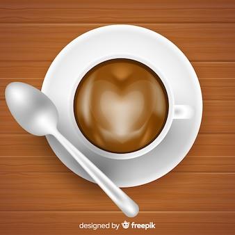 Vista dall'alto della tazza di caffè con un design realistico